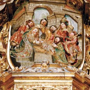 Adoración do neno no retablo da Expectación da catedral de Tui, obra de 1722 de Antonio del Villar (Redondela, Pontevedra). O gaiteiro aquí representado toca unha gaita de fol sinxela na que destaca a ornamentación do vestido do fol. Fotografía do autor.