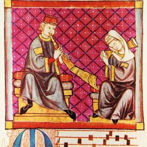 Nesta iluminación da cantiga 300 das Cantigas de Santa María (códice j.b.2, século XIII) aparece un tocador dun gran aerófono da familia das lingüetas duplas; puidera tratarse dun instrumento semellante a unha toba con furados dixitais.