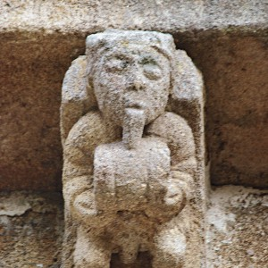 Dolio nun canzorro  de Santa Mariña de Esposende (Ribadavia, Ourense, s. XIII-XIV). Apréciase claramente como o músico coloca os beizos para soprar  no tubo.