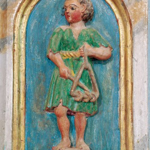 Tocador de ferriños con argolas representado no banco do retábulo de Santa María de Meiraos  (Folgoso do Courel, Lugo, 1614).  Fotografía do autor.